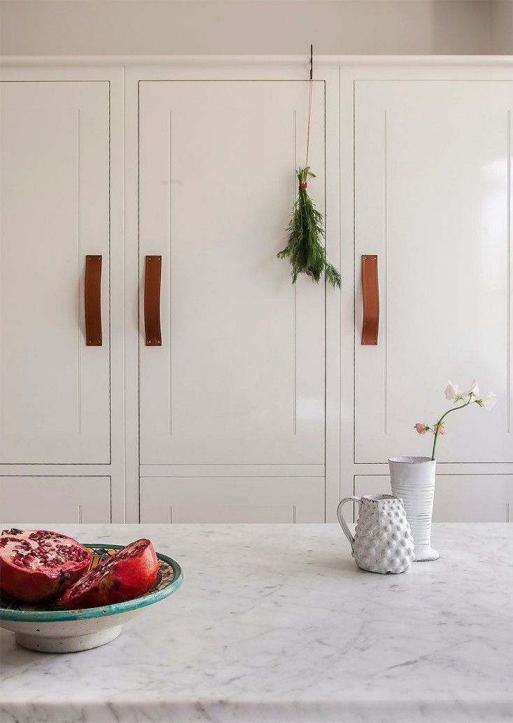 Skye Gyngell kitchen by British Standard, White Cabinets with Brown Leather Pulls, Photography by Alexis Hamilton | Remodelista
