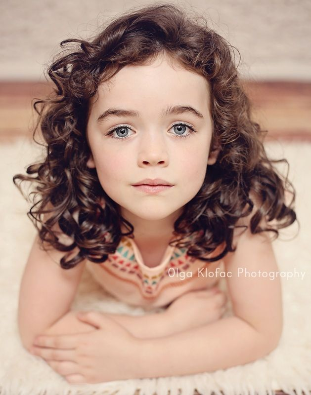 Beautiful 6 Year Old With Dark Long Curly Hair Professional