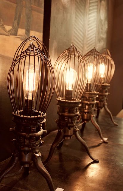 Looks like antique Christmas tree stands with industrial whisks ... cool
