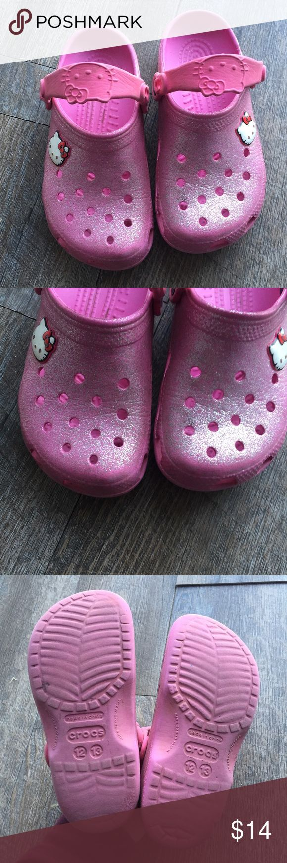 CROCS hello kitty little girl size 12/13 Little girls size 12/13. By the brand CRCOS. Are hello kitty themed. Worn but has life left. Has a glitter texture. Needs to be cleaned up. Smoke free home with pets CROCS Shoes Slippers