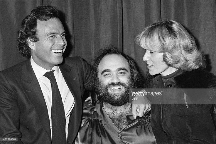 -- This photo taken on December 6, 1978 shows Greek singer Demis Roussos (C) and Spanish singer Julio Iglesias (L) posing following Roussos' concert at the Olympia hall in Paris. Roussos, best known for operatic pop ballads in the 1970s and 1980s, died in Athens at the weekend aged 68, the private hospital that had been treating him said onnJanuary 26, 2015. AFP PHOTO / JOEL ROBINE