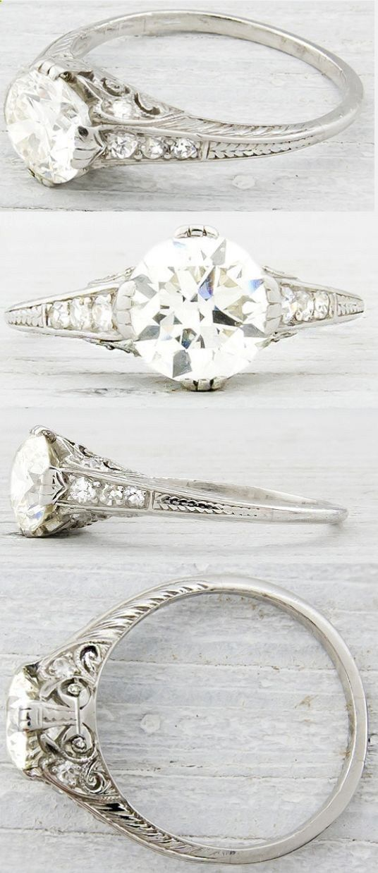Art Deco engagement ring, circa 1930. Embellished with delicate engraving and sparkling side stones, this ring is centered by a 1.20 carat EGL certified old European cut diamond with K-L color and VS2 clarity. Via Diamonds in the Library. , <3