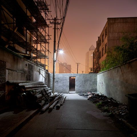 Erin Fitzsimmons photographs urban and rural landscapes and also works commercially in architectural photography. Shanghai Nights was shot in 2011 and focuses on the demise of the old Shanghai. Fitzsimmons writes: