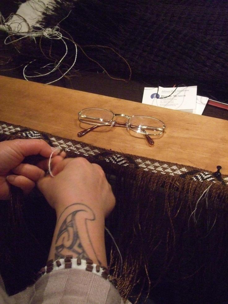 Someone weaving taniko