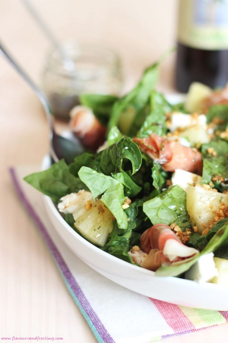 Healthy gourmet salad recipe with spinach leaves, cured ham, toasted hazelnuts, pineapples + goats cheese, drizzled with a honey
