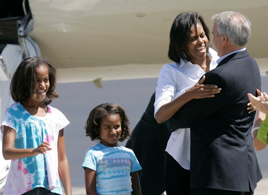 Malia and Michelle warmly greet Colorado Governor Bill Ritter in Denver on August 24th. Sasha doesn't look so sure