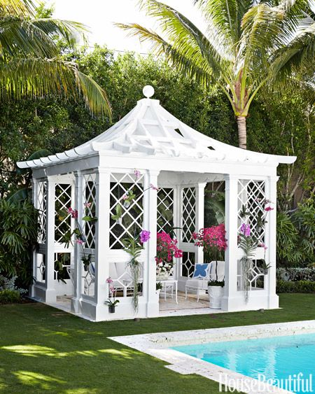 A chinoiserie pagoda by landscape designer Keith Williams is filled with Brown Jordan furniture that blends into the lattice.