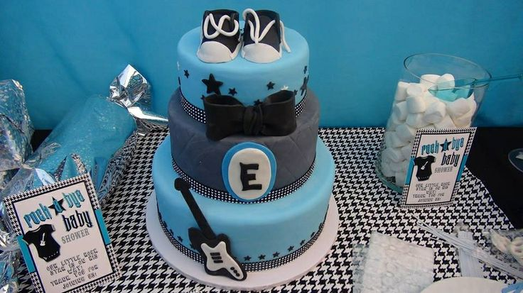 "Rock a bye baby shower cake. I love the little shoes on top! Make the initial to a ""J"" and Converse on top."