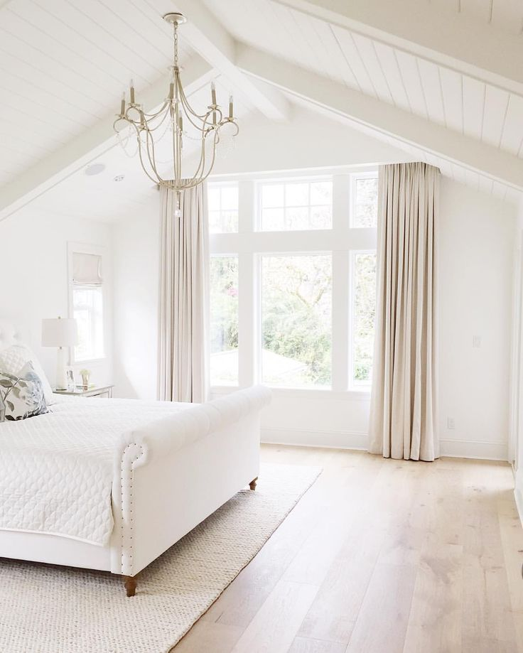 bedroom vaulted ceiling chandelier hardwood floors restoration hardware benjamin moore simply white rugsusa
