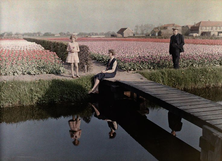 Locals relax by the tulip fields along the canal in Haarlem, The Netherlands, 1931.
