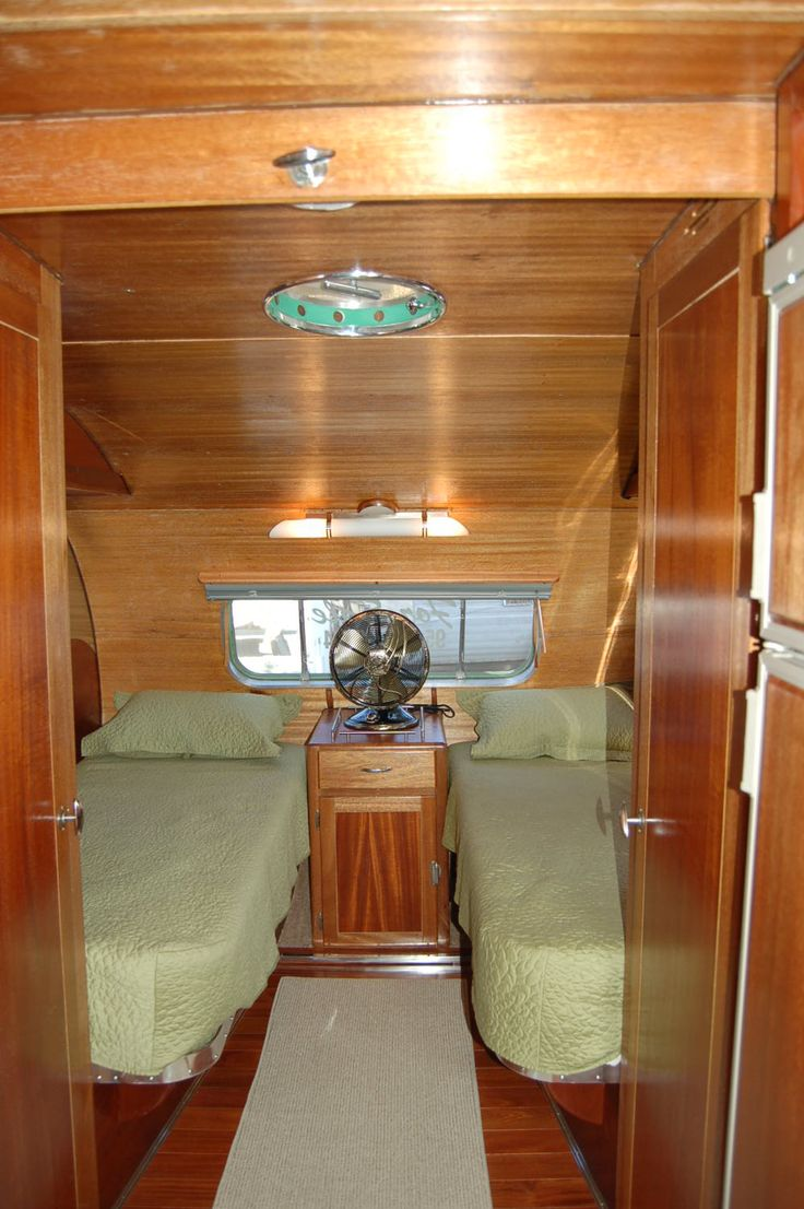 Very cozy bedroom with 2 twin beds in a vintage 1950 airfloat land yacht trailer