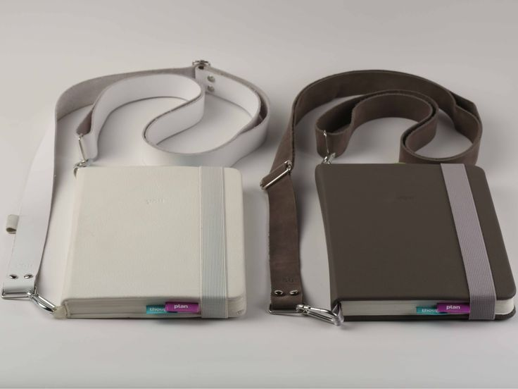 two belted notebooks