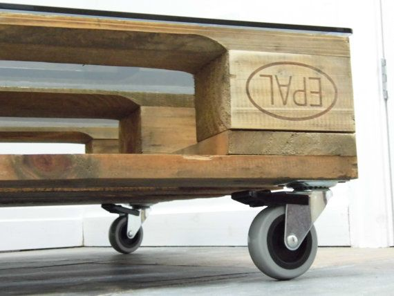 Pallet Coffee Table  This coffee table is perfect for a center piece or side table in any living room or bedroom. The pallet had delivered some materials for another project and we decided to turn into a side table for my own living room.  Wheel sizes: 50mm 75mm Please let us know which wheel size you would like. Glass thickness: 6mm Pallet thickness: 150mm Length: 780mm Width: 670mm  Price: £199.99  Thank you from,  www.siddallanddowning.com