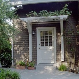 arbor idea for back door--contemporary landscape by Diane Licht Landscape Architect. I have always loved this look. Arboreal over the windows too.