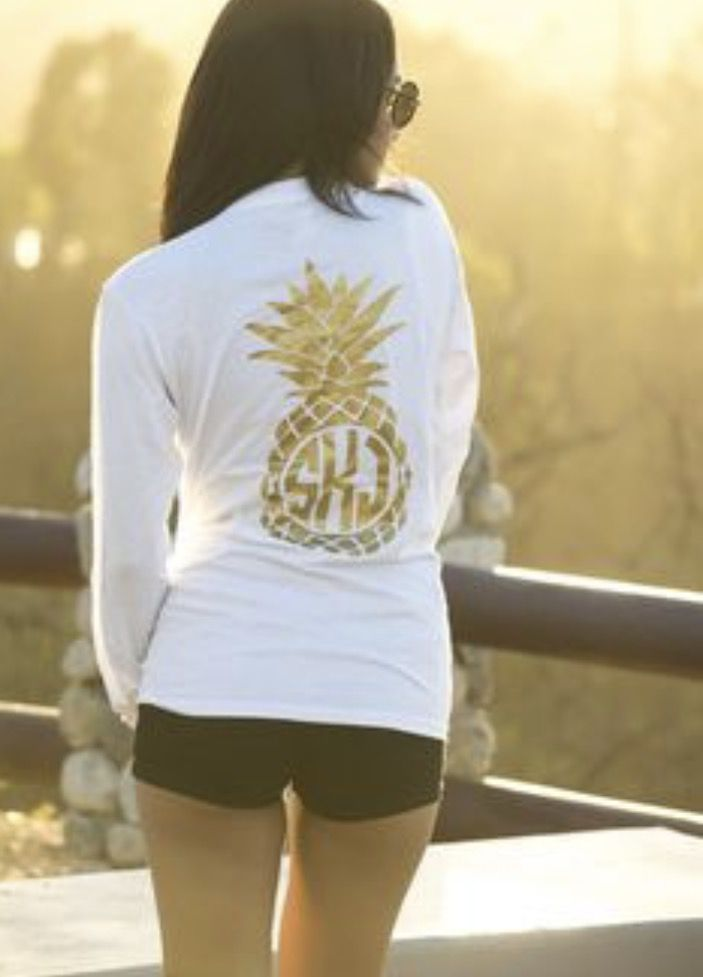 Gold pineapple monogram.