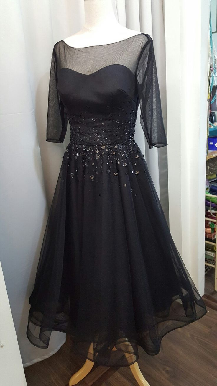 Black tulle dress with beaded detailing at the waist. By Zann & Denn.  Service@zanndenn.com