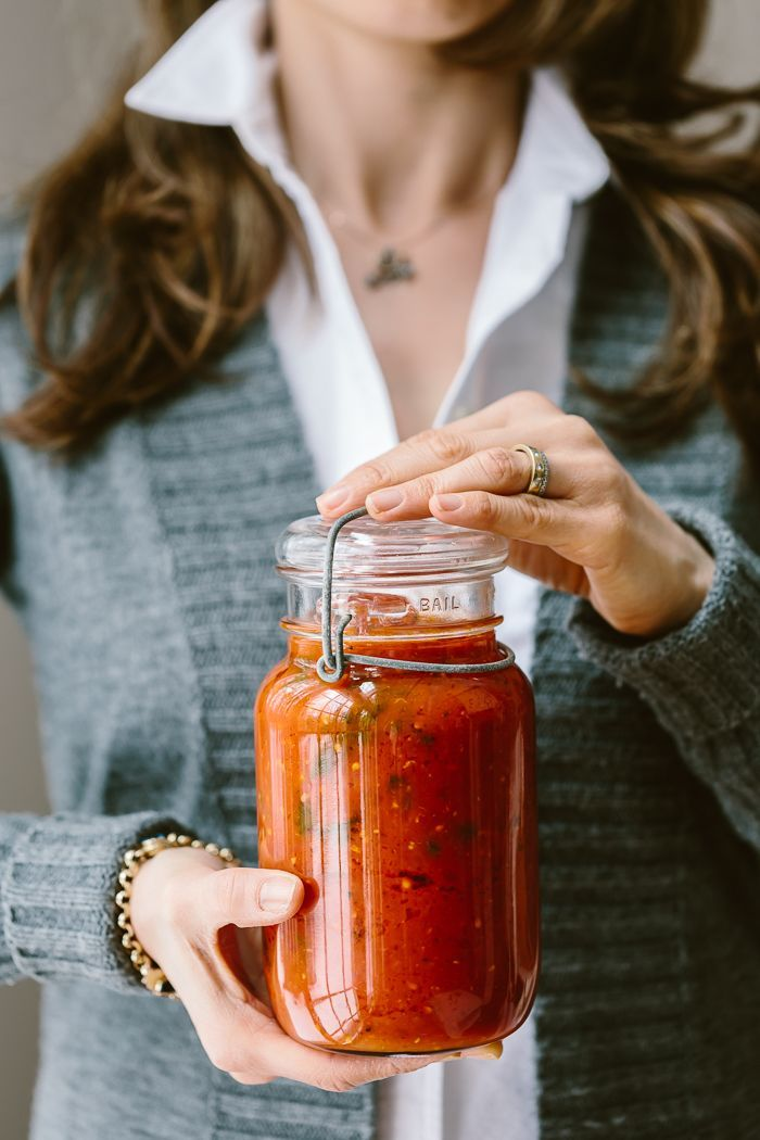 A foolproof recipe for homemade tomato basil sauce with tips and tricks on the use of ingredients and storing and freezing.