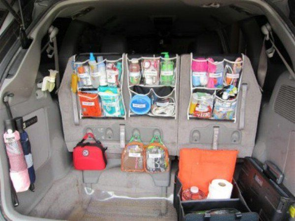A couple of cheap hanging organizers and a few strategically placed Command strip hangers will help you to perfectly organize supplies in your car or minivan.