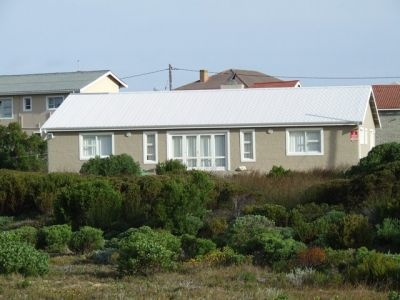 Struisbaai Rental - HR49Mar(  South Africa, Western Cape, Struisbaai  ZAR 800 - ZAR 1000 | 7 Sleeps | 3 Bedrooms | 2 Baths  Fully equipped and neat 3 bedroom Struisbaai vacation house. Secure parking on premises. 10 min walk from harbor, beach and business center. The ideal getaway for a family. Perfect for weekends or longer stays - holiday accommodation!