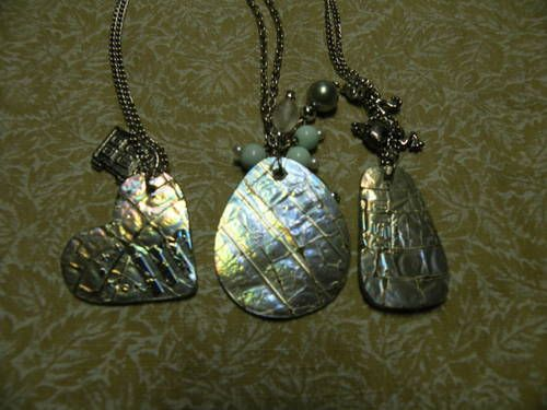 Melted CD pendants.  Best do it outside in a microwave that isn't used for food anymore so you don't get dangerous fumes!