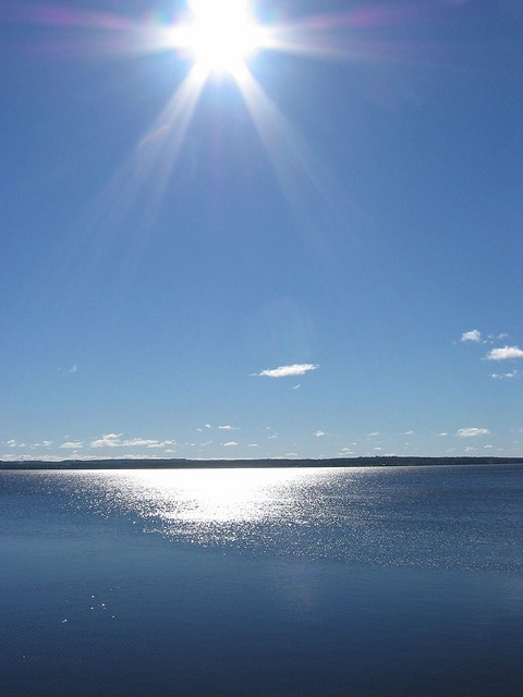 The sun over Grand Lake, NB. Photo by angmombo.