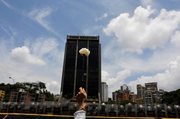 #world #news  Roses in hand, Venezuelan women protesters face security forces