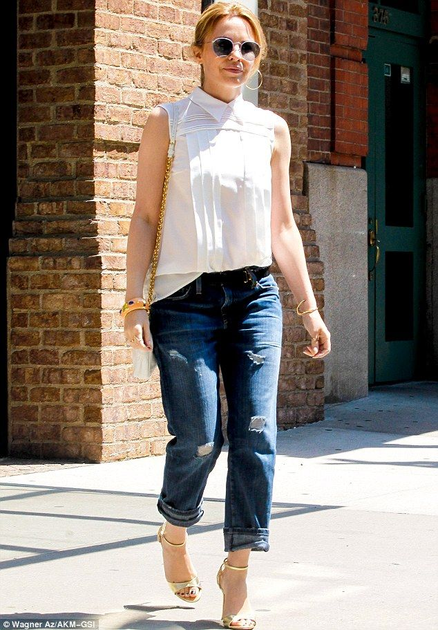 Keeping covered: Kylie Minogue stepped out of her New York City hotel on Friday in an unusually concealing ensemble