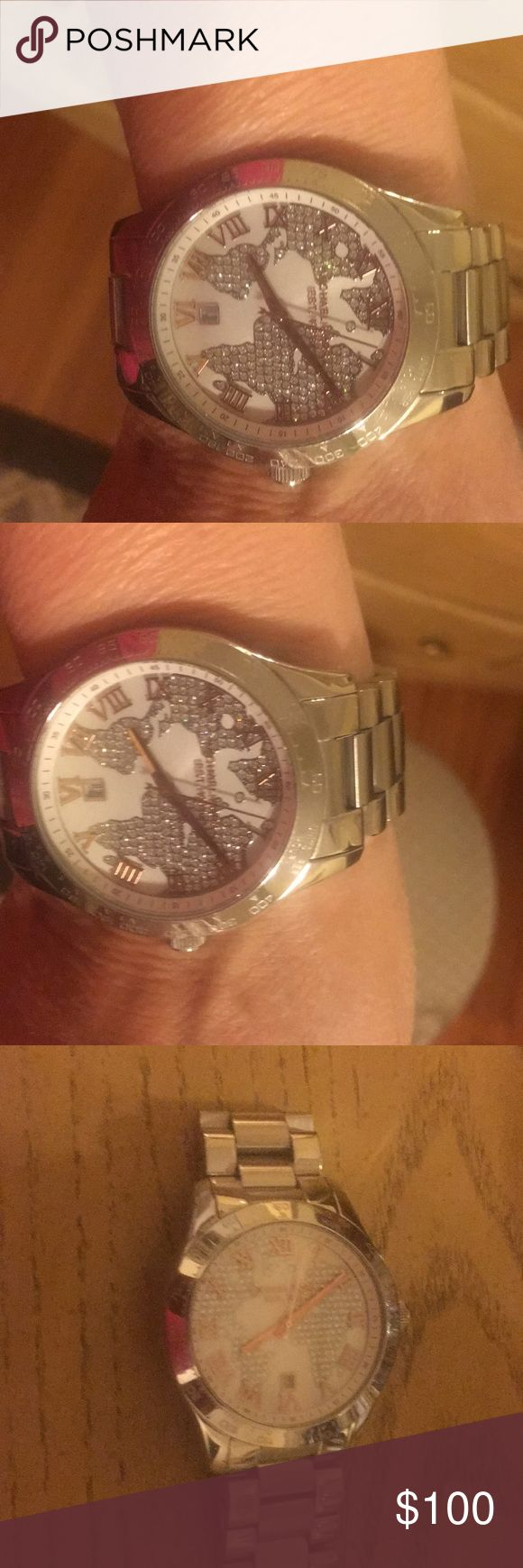 Michael Kors silver watch Stunning silver Michael Kors watch with rose gold. Watch has been used and needs battery. No longer sold in sores. I have received so many compliments. Michael Kors Accessories Watches