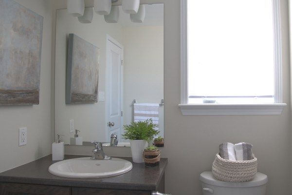 Powder Room Compact bathroom featuring neutral painted walls.