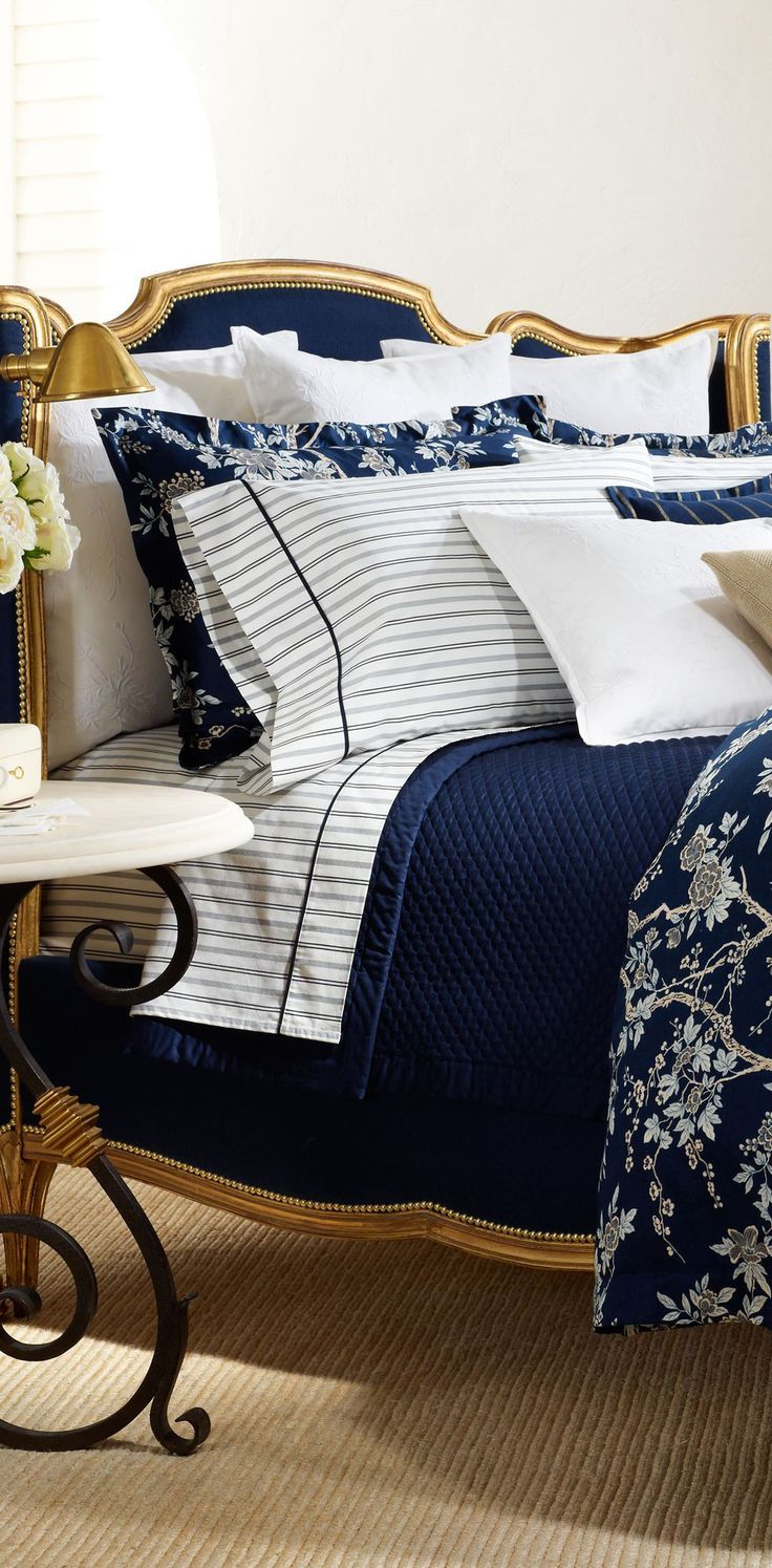 Lovely Ralph Lauren striped sheets with navy quilt and floral printed duvet