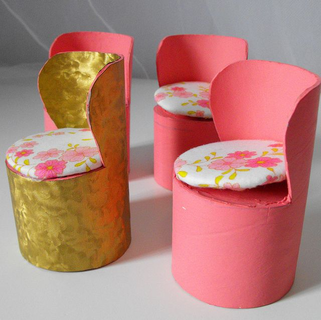 Barbie chair made from toilet paper rolls. Might work as a vanity chair. Also made 4 curved high back chairs from Pringles chips cans, painted black. Need to add cord around cut edges & seat cushions - bigger seats will fit the male dolls better. kj
