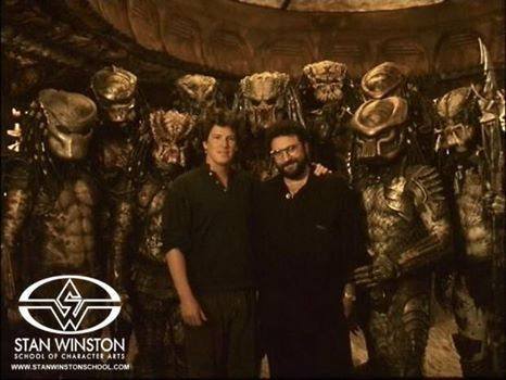 """Director Stephen Hopkins and Producer Joel Silver with group of """"Predators"""" created by Stan Winston Studio for Predator 2 (1990)."""