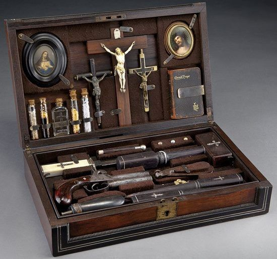 Vampire-killing kit in a rosewood and ebony case from the 19th century