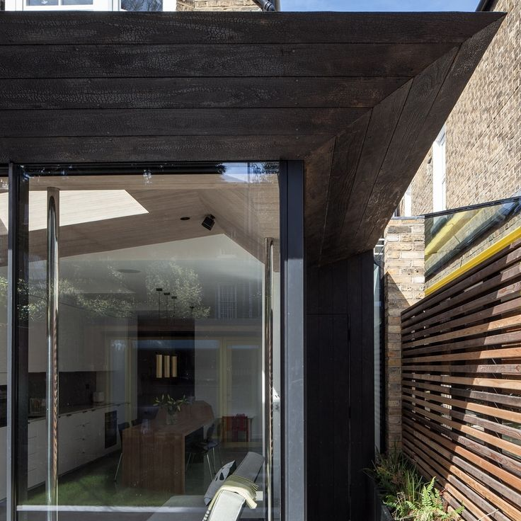 Charred Kebony cladding by Shou Sugi Ban was chosen to provide a long-lasting and attractive timber finish for both the rear and side extension.