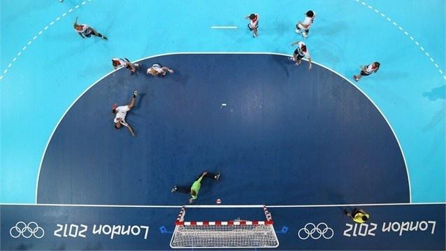 A robotic camera captures the action at the Handball