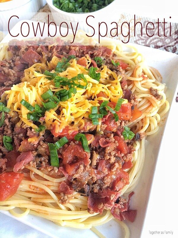 COWBOY SPAGHETTI | ground beef, pastrami, olives, tomatoes over tender pasta with a garnish of green onion and cheese! www.togetherasfamily.com