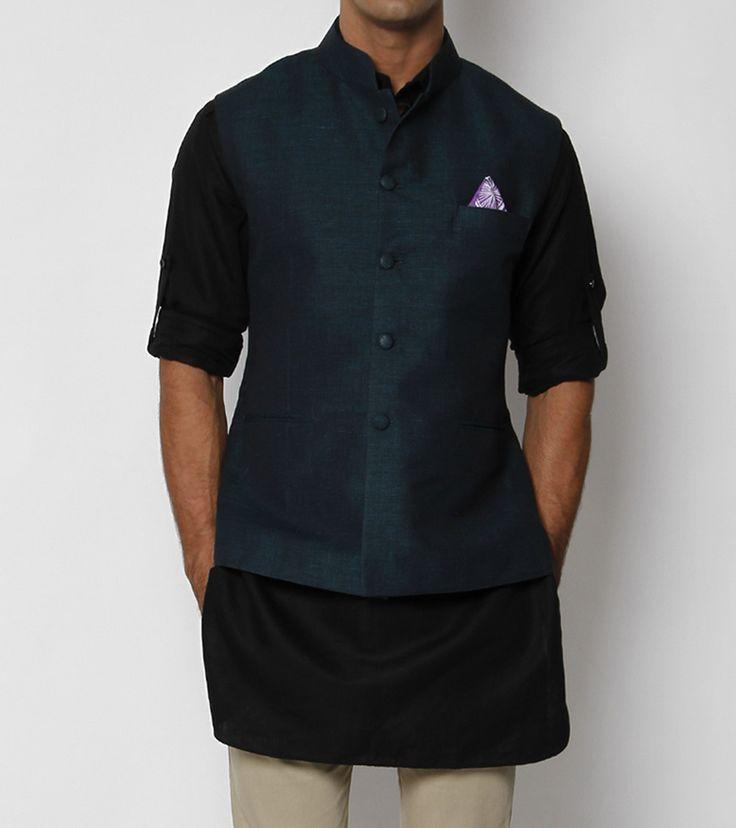 A blue-green cotton linen sleeveless Nehru Jacket featuring a hip length, front button placket running through the length of the jacket & three front pockets.