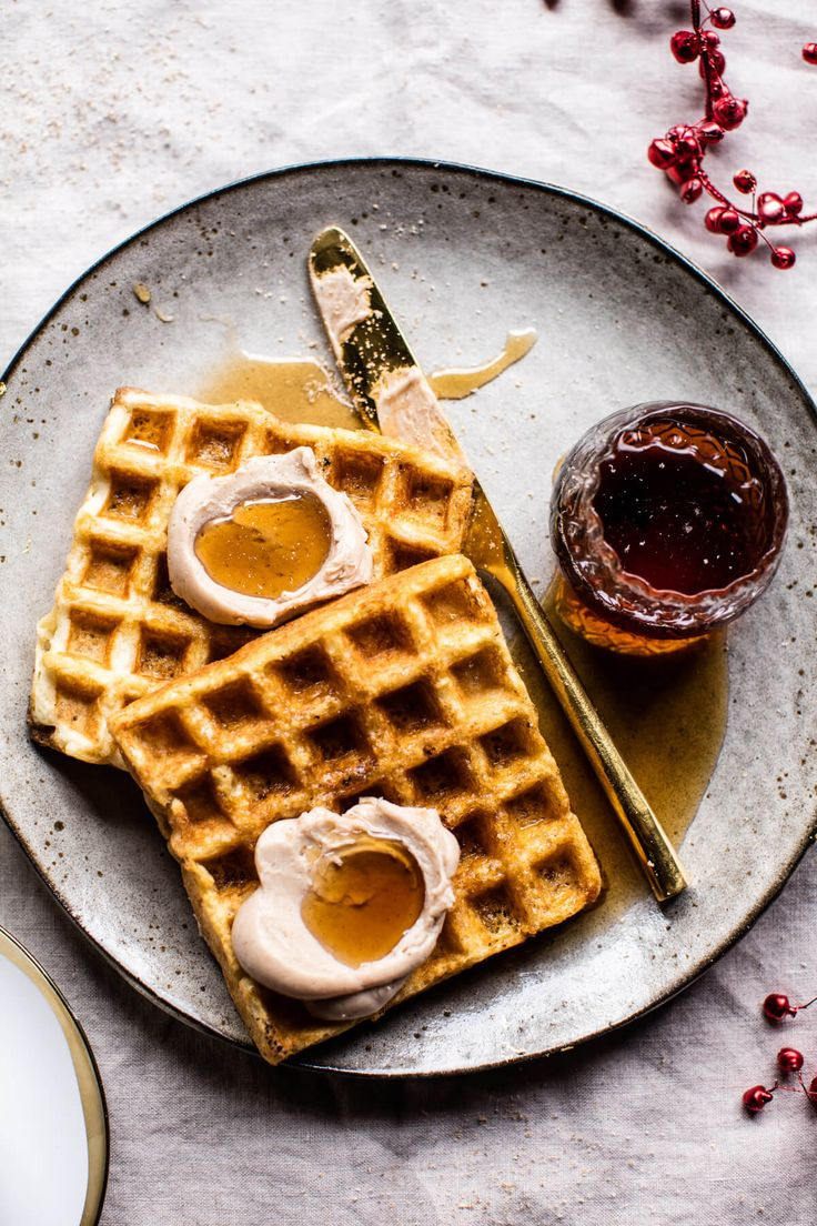 Crispy Belgian Waffles - so good all they really need is a little eggnog scented butter, and a drizzle of real maple syrup! From halfbakedharvest.com