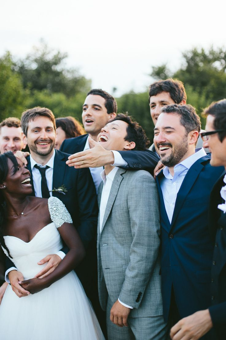 Grey and Navy Wedding | Happiest bridal party ever!! This fun outdoor wedding was fun for everyone! The beautiful bride and groom look like they are having the time of their lives with all of their handsome groomsmen by their sides in their dapper navy suits