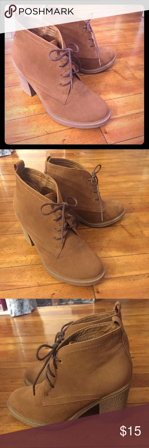 Camel/Chestnut Booties Worn 2x. Condition fair, like new. I have similar boots like these, so I won't be needing this anymore. It's super cute, comfortable, and pretty lightweight. It doesn't make too much noise when you walk. The soles on the bottom of the shoe is great quality. Price as is. No offers please. No trades also. Shoes Ankle Boots & Booties