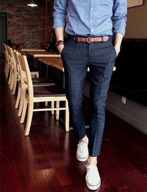 Shop this look on Lookastic:  https://lookastic.com/men/looks/dress-shirt-dress-pants-plimsolls-belt-bracelet/12649  — Blue Chambray Dress Shirt  — Navy Canvas Belt  — Dark Brown Bracelet  — Navy Check Dress Pants  — White Plimsolls