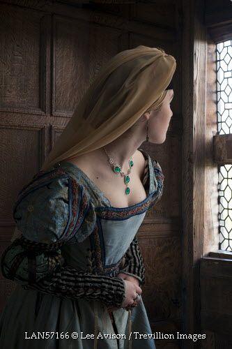 © Lee Avison / Trevillion Images - tudor-medieval-woman-looking-through-window