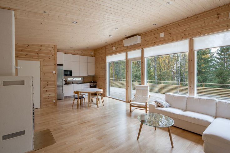 These Log Cabin Kit Homes From Finland Are Surprisingly Sleek - Photo 9 of 15 - A perfect example of a clean-lined, Scandinavian home, Jurmo has an efficient floor plan with large windows and terraces that promote an indoor/outdoor lifestyle.