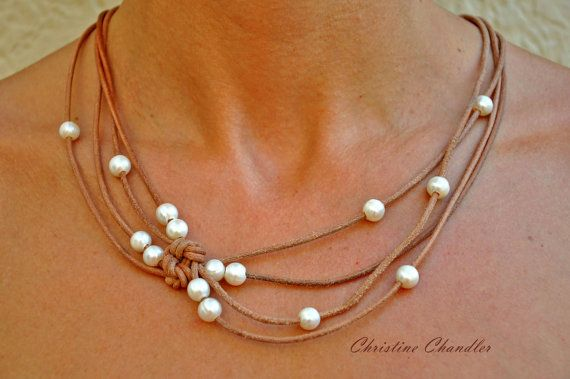 This Pearl and Leather Necklace is a very elegant piece to add to your wardrobe. The necklace lightly cascades from the neck in four loose