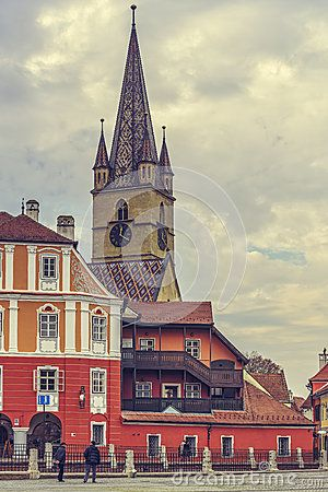 Sibiu, Romania - 11 November, 2015: The 73.34 m high steeple with clock and four turrets of the Evangelic Church, the landmark of the city, built in 1530 in the Huet Square in Sibiu, Romania.