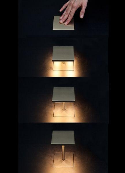 Pop up desk light 'spingi qua' designed by Mario Nanni
