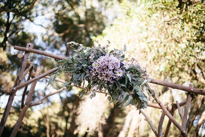 Wooden arch, gorgeous flower arrangement to match our wedding colours