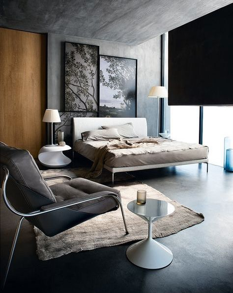 We love this grey bedroom full of contrasts: Dark and light colors correlate with each other in the same way as the straight and curvy lines. We love the grey ceiling and the leather chair als much als we love the large and modern bed and the round side table.  Click to find more interior inspiration!