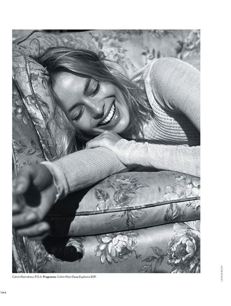 Flashing a smile, Margot Robbie wears Calvin Klein dress