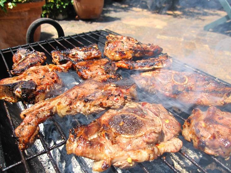 Braaivleis - South Africa. Various meats BBQ on wood fire.